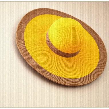 Wyciągnęłam słomkowy kapelusz...