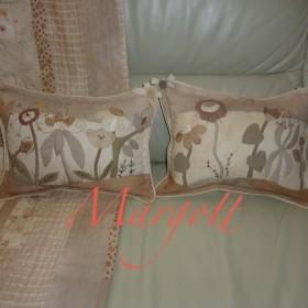quiltowe poduszki w pastelowych barwach