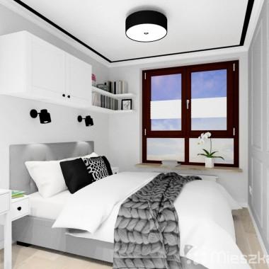 Sypialni jest zaaranżowana w biało - szarej kolorystyce, z dodatkiem kilku czarnych elementów.