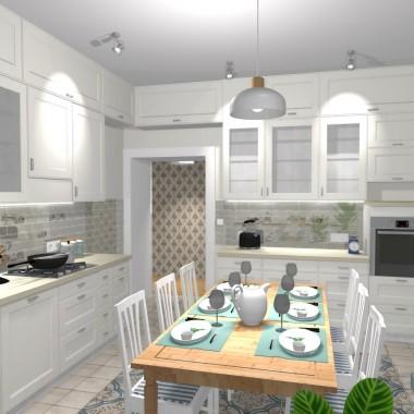 Klienci z jednego mieszkania postanowili na powrót zrobić dwa. Pomieszczenie starej kuchni zmieniło swoją funkcję, a nowa musiała powstać w salonie. Życie rodzinne i towarzyskie rodziny i tak toczy się w kuchni, więc ta zmiana nie była kłopotliwa ze względów użytkowych.