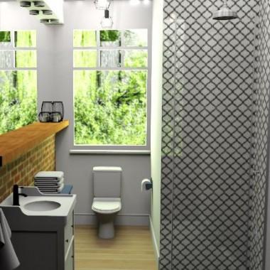 Łazienka gościnna, więc funkcje przechowywania ograniczone zostały do minimum. Na całej ścianie nad umywalką lustro, które ma na celu poprawienie proporcji długiej i wąskiej łazienki. Pod lustrem półka z grubego kawałka starego drewna. Cegła, ściana prysznica oraz lampy wiszące nawiązują do klimatów loftowych :)