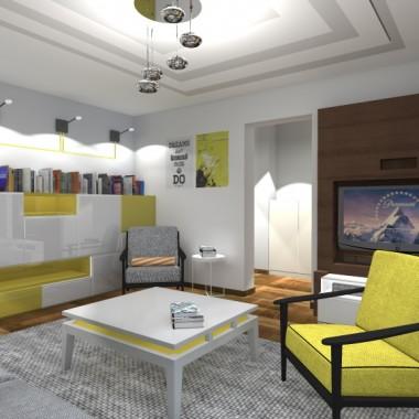 Salon z grafiką, z dodatkiem koloru żółtego.