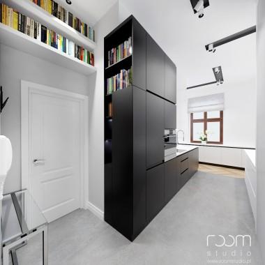 Minimalistyczne, nowoczesne wnętrze w odważnych kolorach. Prosta kuchnia wraz z zabudową korotarza wykonana ze spieków kwarcowych, niezwykle ciekawego materiału.