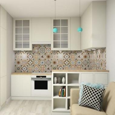 Projekt zakładał przeniesienie kuchni do salonu. Przestrzeń ma niespełna 20 m2, pomimo tego udało się wygospodarować całkiem funkcjonalną kuchnię. Aby nie zmniejszać optycznie pomieszczenia zaproponowałam jednolitą podłogę. Umowną granicę pomiędzy kuchnią a salonem wyznacza barek, który świetnie zasłania zlew i stanowi dodatkowe miejsce do przechowywania w zmniejszonym pokoju dziennym. Dzięki temu powstał też dodatkowy fragment blatu. Ze względu na rozmiary pomieszczenia, oświetlenie górne stanowi jeden duży plafon. Lampę nad stołem zastąpiła lampa stojąca. Sprzęt AGD jest biały, aby jak najmniej rzucał się w oczy. Lustra nad sofą pełnią nie tylko funkcję dekoracyjną, ale także powiększają i rozświetlają wnętrze. Zapraszam do oglądania i dzielenia się spostrzeżeniami.:)