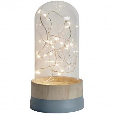 Lampka dekoracyjna led lampka nocna. Drewniana podstawa na której widnieje szklany klosz z kropelkami światła led w środku. Lampka dostępna na bogatewnetrza.pl