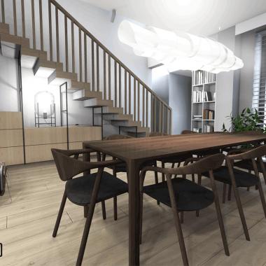 Wnętrze prezentuje się w kolorach szarości, z uwagą skupioną na doskonałym wyborze drewna - zarówno mebli stolarskich, jak i krzeseł czy stołu. Pięknie zaprojektowane i perfekcyjnie wykonane w połączeniu z szarością wnoszą do aranżacji spokój i równowagę. To klasyczna elegancja w najlepszym wydaniu.