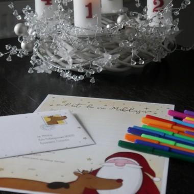Dzieci zaczynają pisać list do Mikołaja