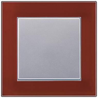 Przycisk pojedynczy, aluminiowy z ramką ze szkła barwionego.