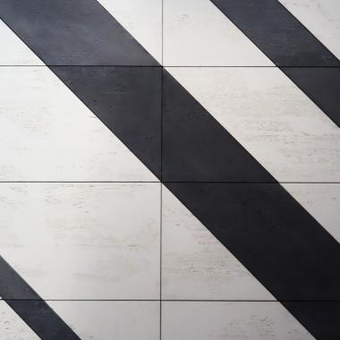 LUXUM - mozaika z betonu architektonicznego. Do aranżacji wykorzystano płyty betonowe w kolorze białym i czarnym.