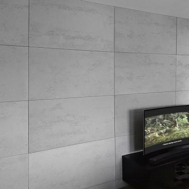Płyty betonowe z betonu architektonicznego Luxum na ścianie w salonie.