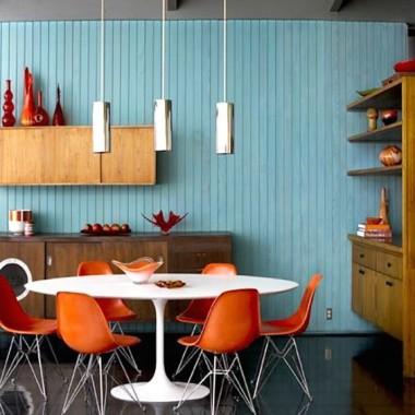 Nowoczesne wnętrza wyposażone designerskie meble i dodatki w stylu mid century.